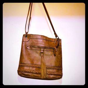 Brown cross body tote bag. With fringe tassel